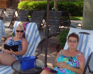 Sandy and I enjoying our books poolside