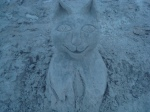 Cat sand sculpture on beach in front of our hotel