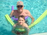 Derek and grandpa having fun at the pool.