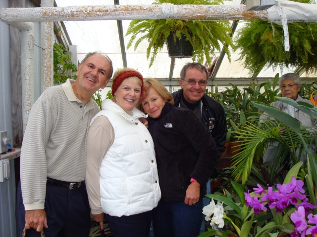Enjoying the orchids are Ken and Lynn Breakiron and Lorraine and John Morelli