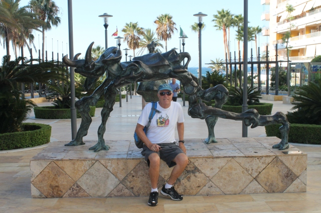 Randy sitting with the Elefante Cosmico (Cosmic Elephant by Dali)