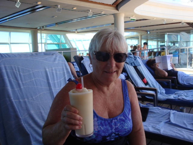 Enjoying an ice-cold pina colada.